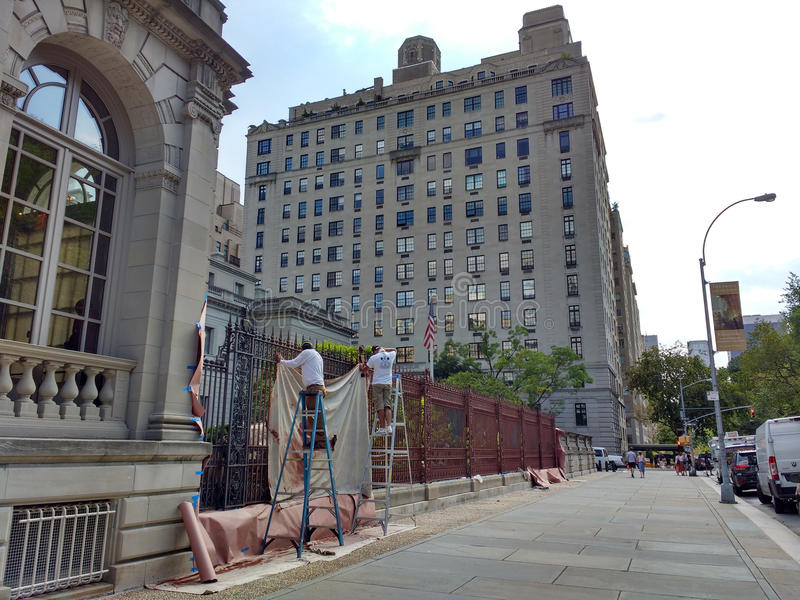 The Frick Collection, Painters on Ladders Painting the Fence, New York City Museum, 5th Avenue, NYC, NY, USA royalty free stock images