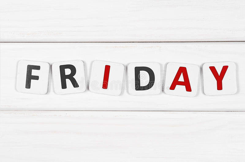 Friday. Inscription on Friday against a white wood texture royalty free stock image