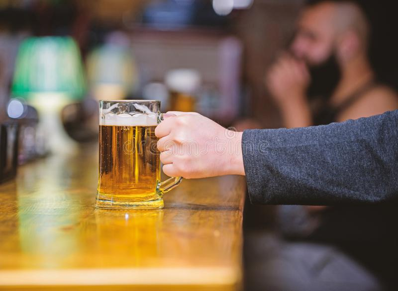 Friday leisure tradition. Beer pub concept. Weekend lifestyle. Beer mug on bar counter defocused background. Glass with. Fresh lager draft beer with foam. Mug royalty free stock photo