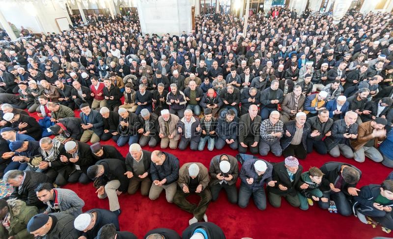 Friday prayer is a prayer performed once a week by Muslims. ISTANBUL, TURKEY - DEC 8: Friday pray in congregation male Muslims Fatih Mosque on December 8, 2017 stock photography
