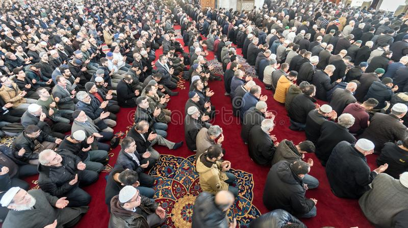 Friday prayer is a prayer performed once a week by Muslims. ISTANBUL, TURKEY - DEC 8: Friday pray in congregation male Muslims Fatih Mosque on December 8, 2017 stock images