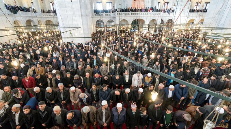 Friday prayer is a prayer performed once a week by Muslims. ISTANBUL, TURKEY - DEC 8: Friday pray in congregation male Muslims Fatih Mosque on December 8, 2017 royalty free stock photography