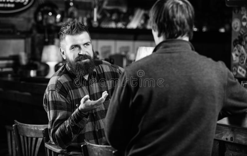 Friday relaxation in bar. Friends relaxing in bar or pub. Interesting conversation. Hipster brutal bearded man spend. Friday relaxation in bar. Friends relaxing royalty free stock images