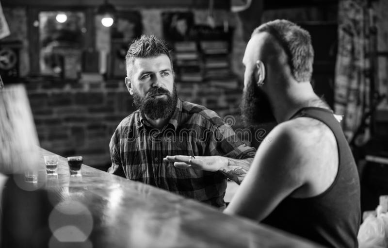 Friday relaxation in bar. Friends relaxing in bar or pub. Soulmates drunk conversation. Hipster brutal bearded man spend stock image