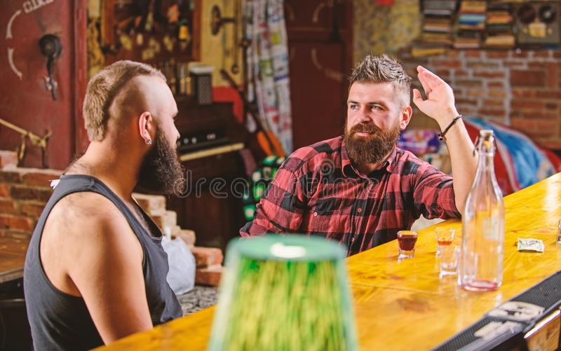 Friday relaxation in bar. Opening hours till last visitors. Friends relaxing in bar or pub. Hipster bearded man spend. Friday relaxation in bar. Opening hours royalty free stock photography