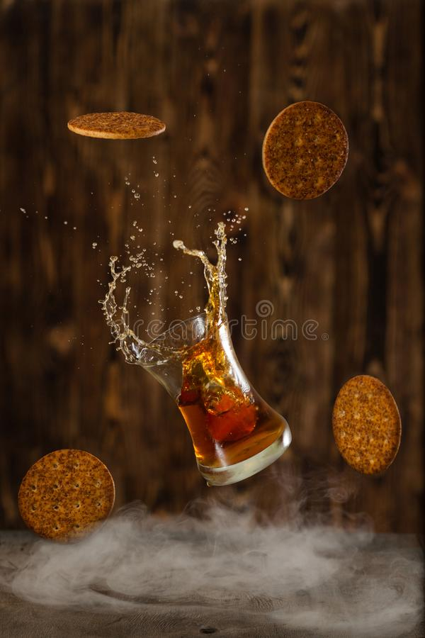 Friday whisky with splash and cookies stock images