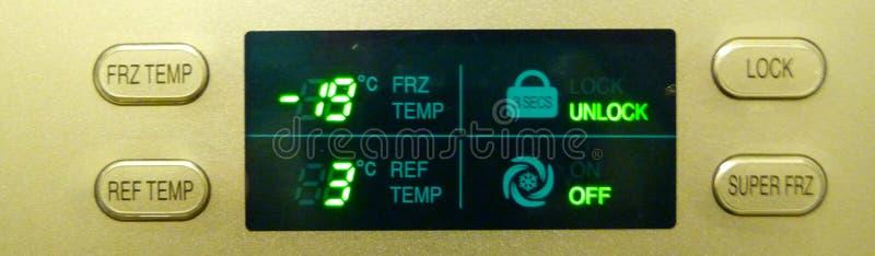Fridge digital display. Temperature controls on an American fridge freezer stock images