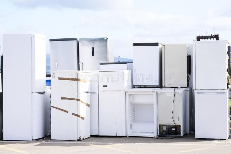 Fridge freezers outdoors at recycle depot for safe disposal refrigeration equipment and gas. Uk stock images
