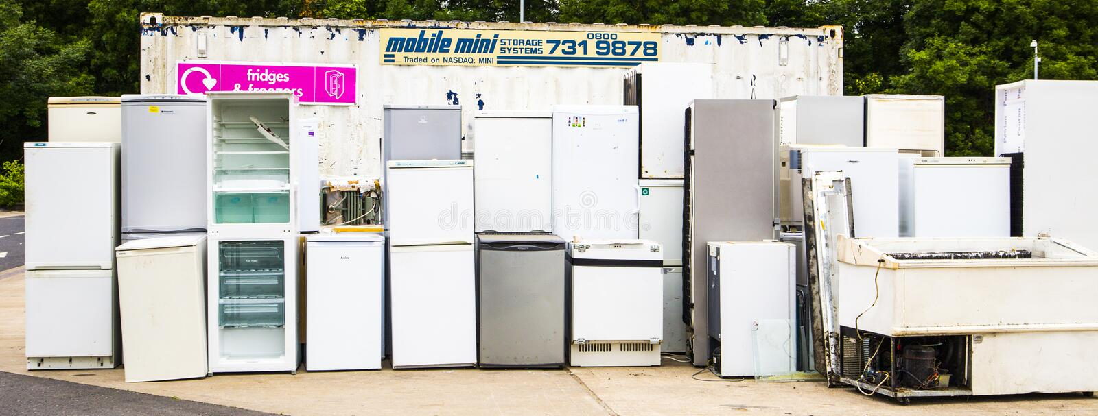Fridge Recycling Point. A large collection of old fridges and freezers left at a council recycling site. Fridge and Freezer Recycling royalty free stock photo