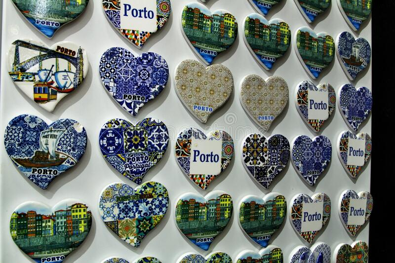 Fridge souvenir magnets imitating portuguese tiles. With the word Porto writen on them for sale in Porto retro artistic colorful craft decorative design lisbon stock images