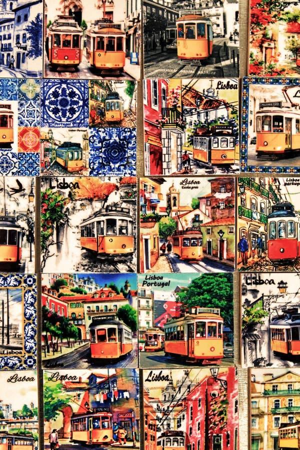 Fridge souvenir magnets imitating portuguese tiles with trams stock photos