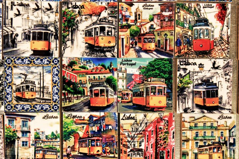 Fridge souvenir magnets imitating portuguese tiles with trams stock photo
