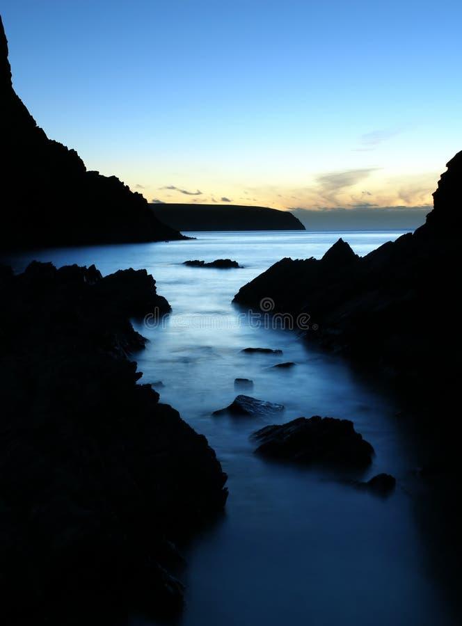 fridsam solnedgång royaltyfri bild