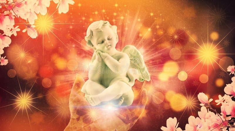 Fridsamt behandla som ett barn ängeln på en abstrakt hand av guden royaltyfri foto