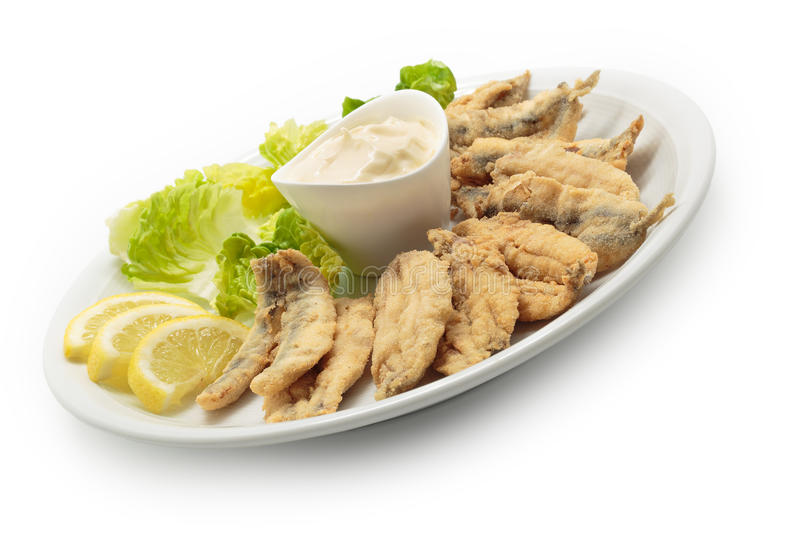 Fried anchovies with salad and mayonnaise stock photo