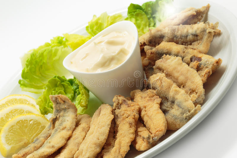Fried anchovies with salad and mayonnaise royalty free stock photo