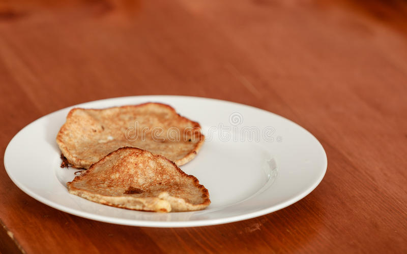Fried apple in pancake dough or apple fritters with icing sugar stock image