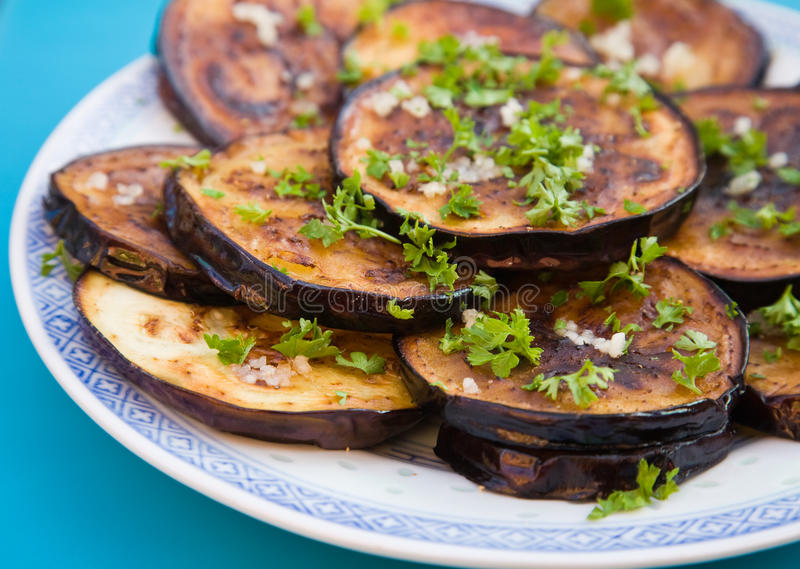 Fried aubergines stock photos