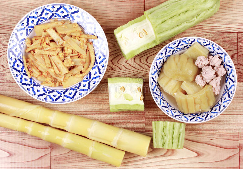 Fried bamboo shoots with egg ,Chinese bitter gourd with meat ball . Fried soft bamboo pole shoots with egg served with streamed Chinese bitter gourd with meat stock image