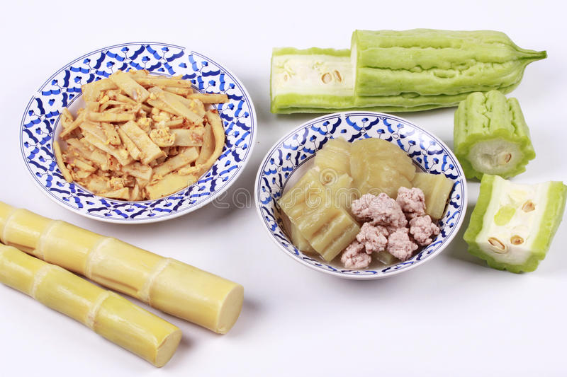 Fried bamboo shoots with egg ,Chinese bitter gourd with meat ball . Fried soft bamboo pole shoots with egg served with streamed Chinese bitter gourd with meat royalty free stock photos