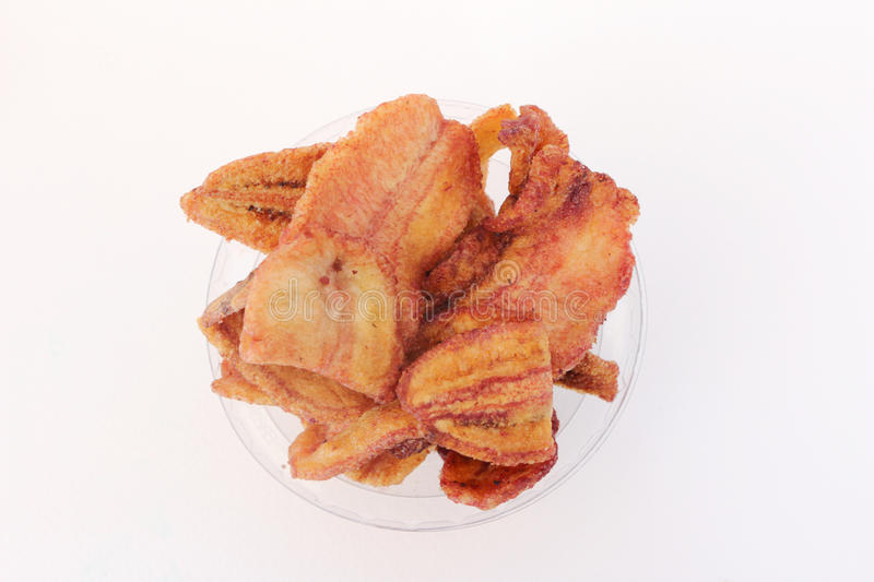 Fried banana. Cup of fried banana on white background royalty free stock photography