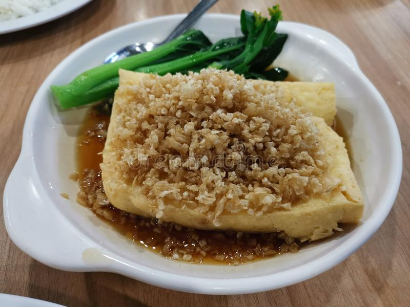 Fried bean curd dish with black sauce. Crispy, delicious, meal, snacks royalty free stock photo