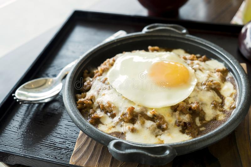 Fried Beef on Rice and Cheese with Fried egg in the Resturant royalty free stock photos