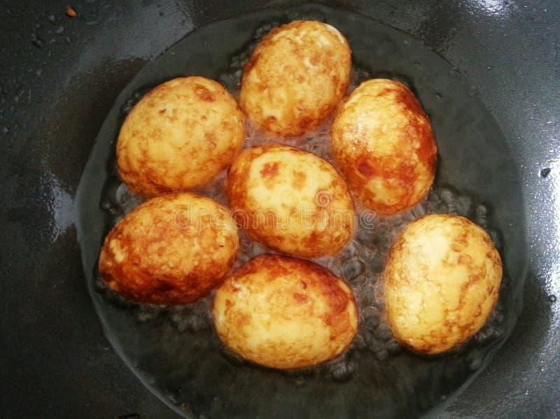 Fried boiled eggs for cook Kai look koey Thai food. Boiled eggs fried in the oil for cooking kai look koey royalty free stock image