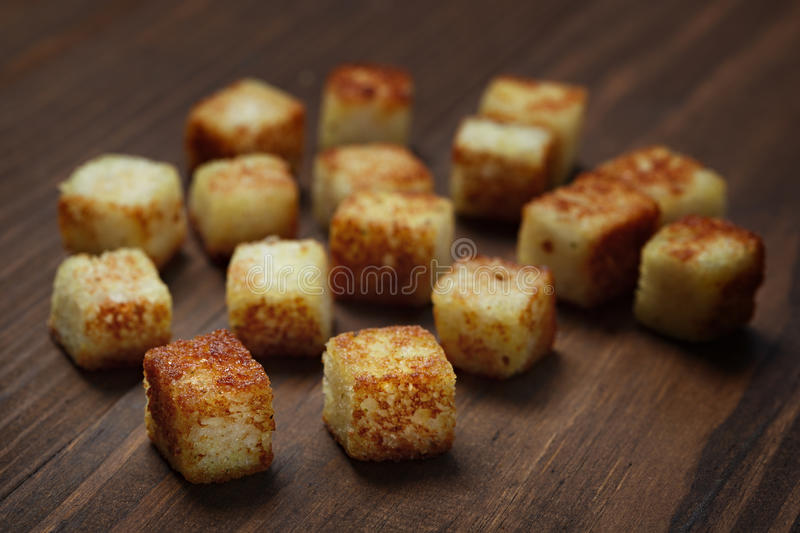 Fried bread cut into cubes cooking. Fried bread cut into cubes for cooking stock photography