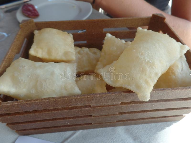 Fried bread, a typical dish from the Emilia Romagna region of Italy. Served in a basket stock photos