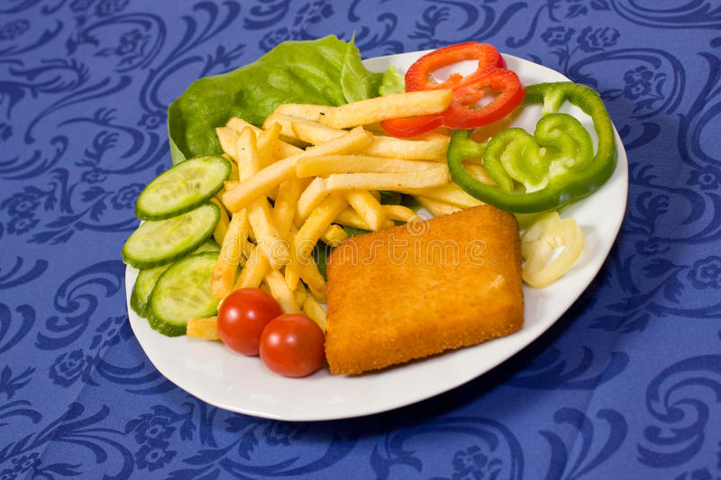 Fried breaded cheese. Steak with french fries and vegetable stock image