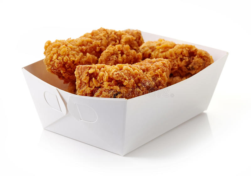 Fried breaded chicken wings in white cardboard box stock images