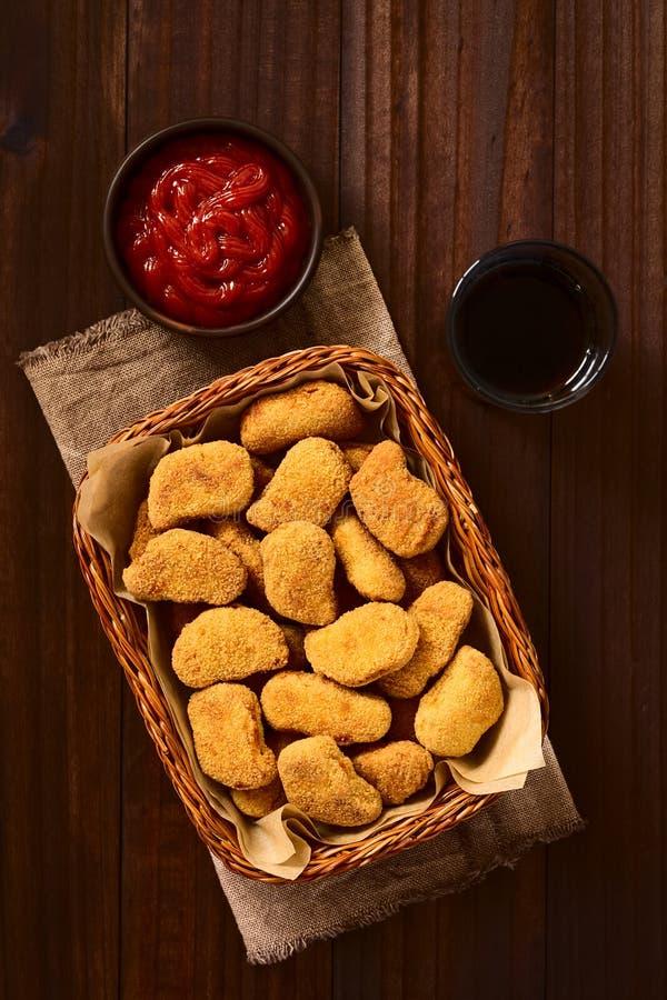 Fried Breaded Crispy Chicken Nuggets arkivfoton