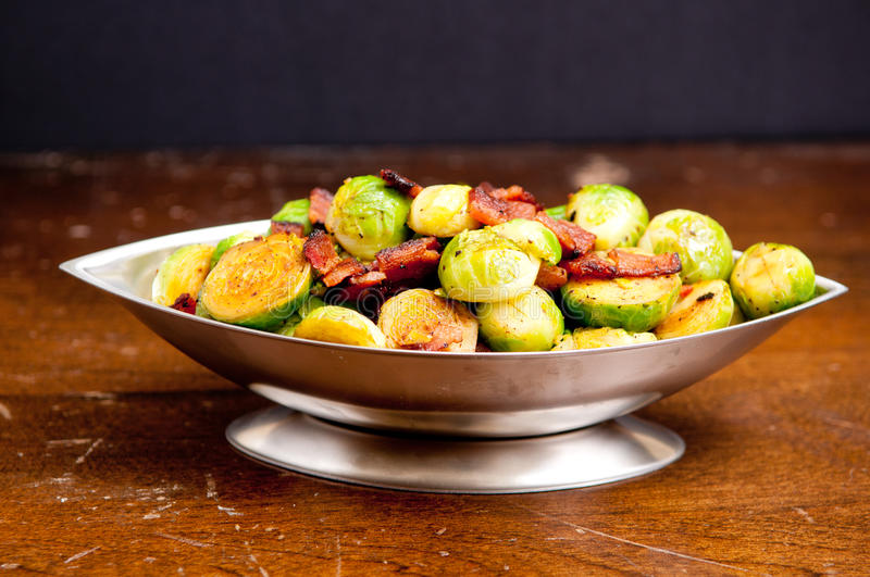 Fried brussel sprouts with chopped bacon stock photos