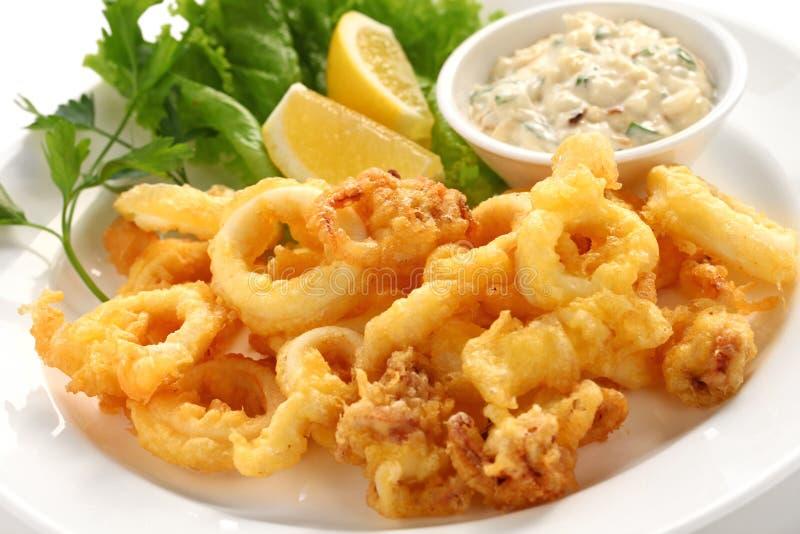 Fried calamari. Fried squid with tartar sauce stock photo