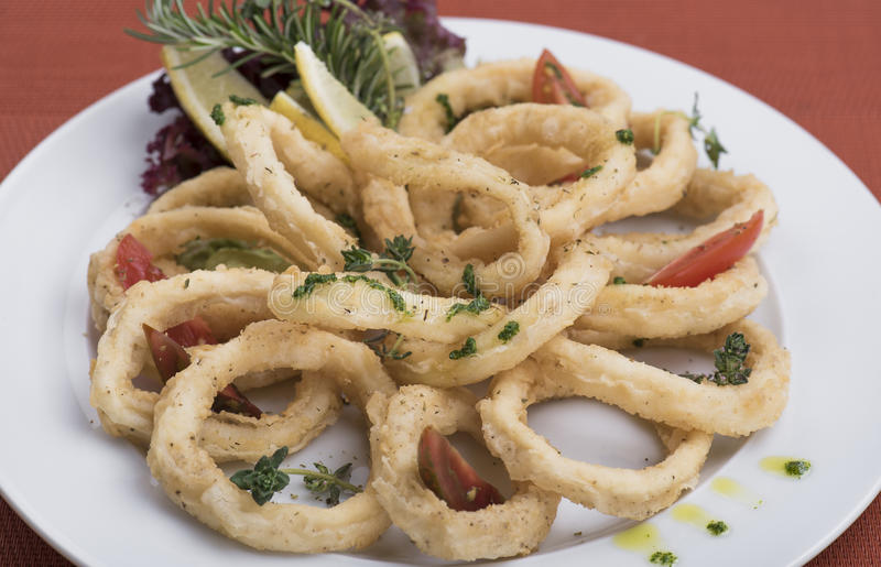 Fried calamari rings 2. With herbs royalty free stock photo