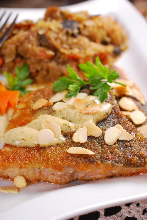 Fried carp with almonds and sauerkraut for christmas eve royalty free stock image