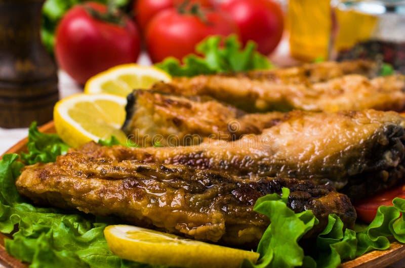 Fried carp slices royalty free stock image