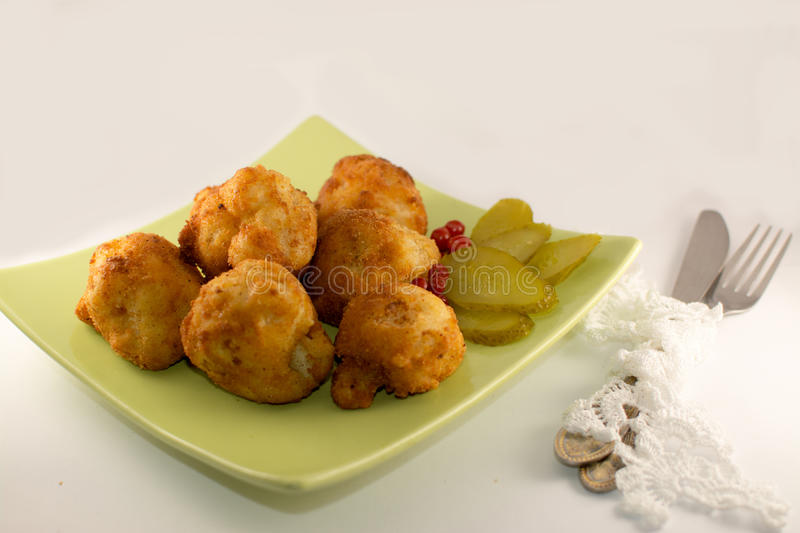 Fried cauliflower on a green plate royalty free stock image