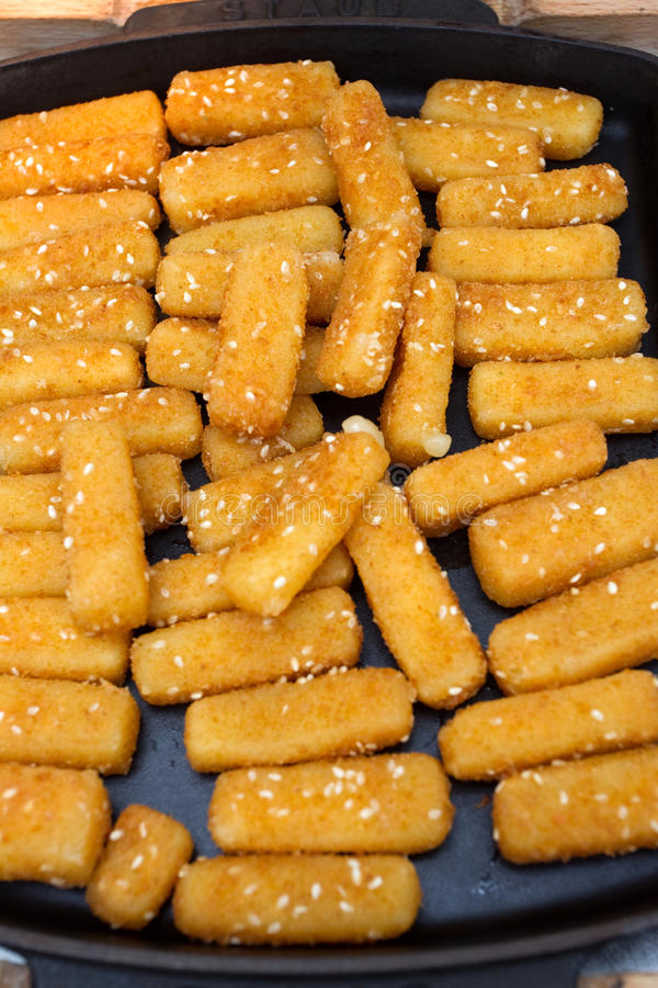 Fried cheese. Some fried cheese with sesame stock images
