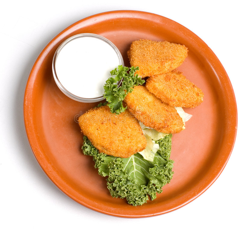 Fried Cheese. Plate of fried appetizers with dressing and garnish stock image