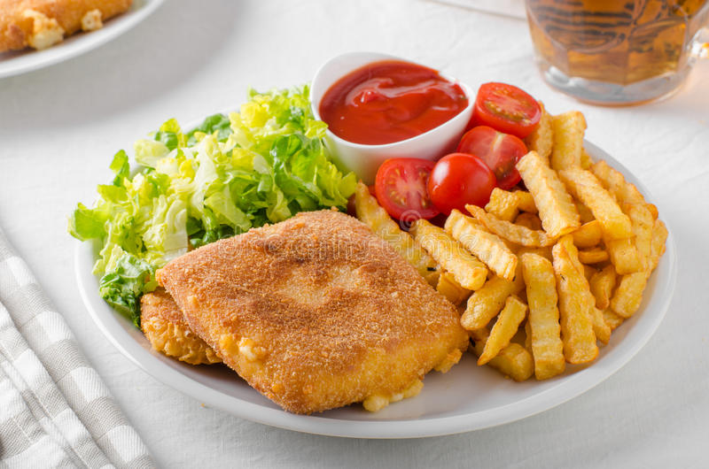 Fried cheese with french fries and lettuce stock photo