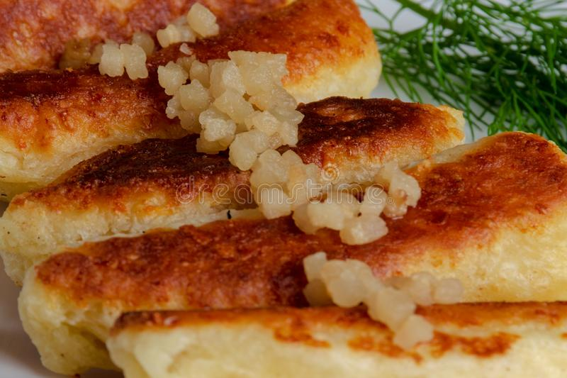 Fried cheese and kefir sticks served in white plate. Made from cheese, flour and kefir. royalty free stock image