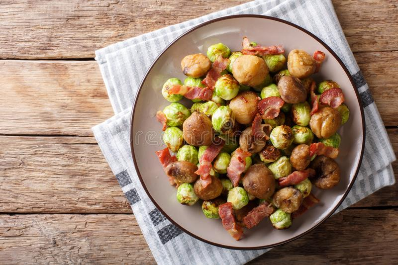 Fried chestnuts, brussels sprouts and bacon closeup. horizontal royalty free stock image