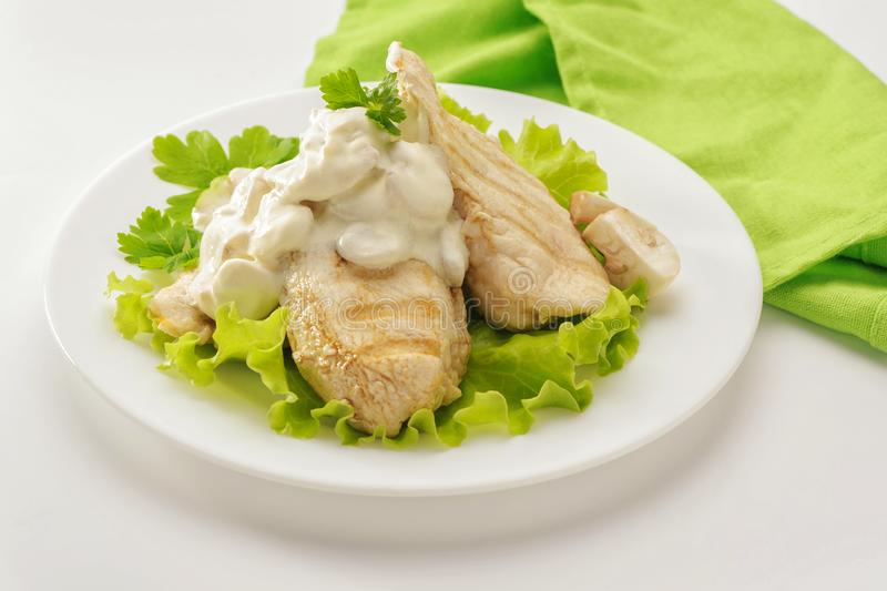 Fried chicken breast with cream sauce stock image