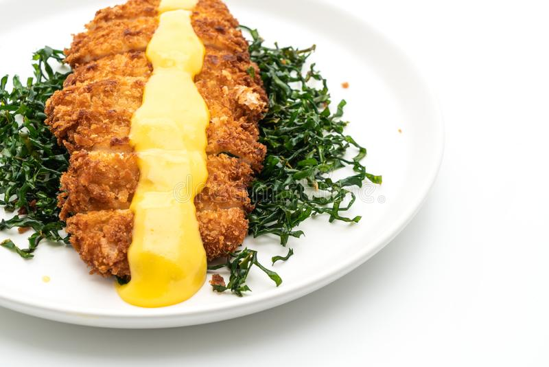 Fried chicken breast with lemon lime sauce. On white background stock photos