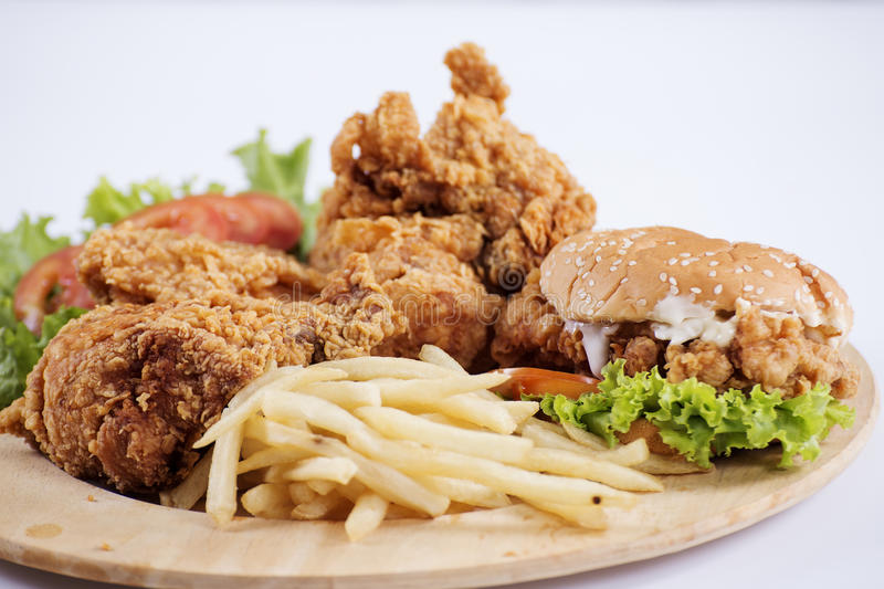 Fried chicken, burger and french fries stock photo