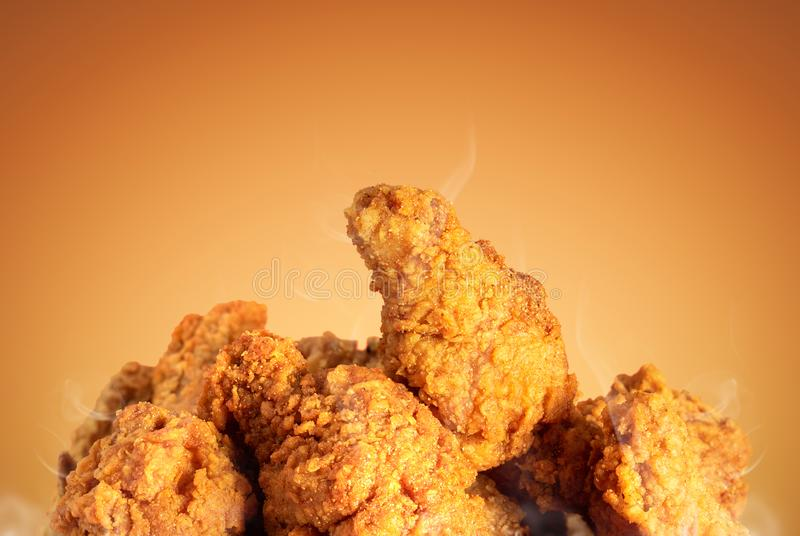 Fried chicken or crispy kentucky on brown background. Delicious hot meal with fast food stock images
