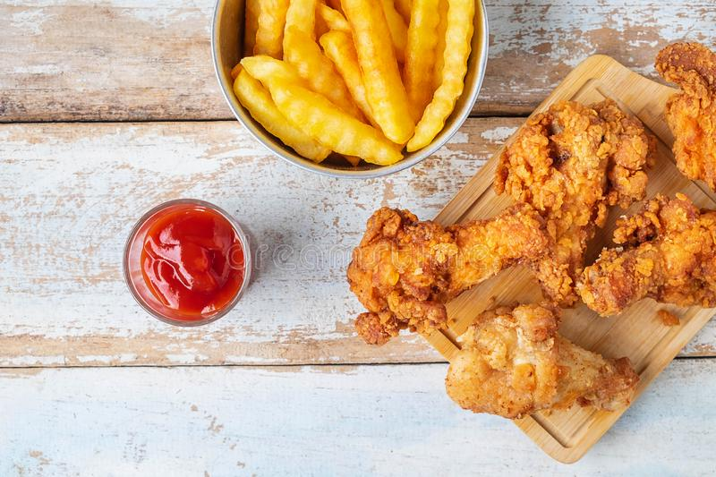 Fried chicken food and french fries on a wooden table stock images