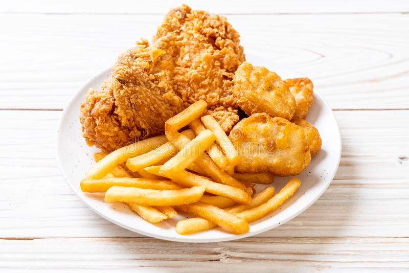fried chicken with french fries and nuggets meal royalty free stock images